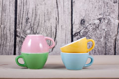 Cups on table over wooden background Stock Images