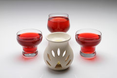 Cups of tea. Three red tea glass on the table with fragrance ceramic container Stock Images