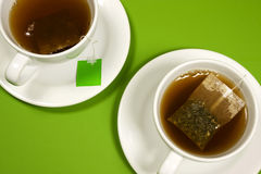 Cups of tea. On green background Royalty Free Stock Photos