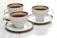 Cups with tea or coffee Stock Images