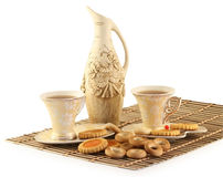 Cups with tea and cookies Royalty Free Stock Images