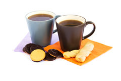 Cups of tea and cookies stock photography