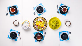 Cups with tea and delicious cake on the table, top view Royalty Free Stock Image