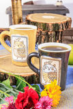 Cups of tea with flowers on wooden table Stock Photo