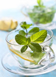 Cups of tea with fresh mint and lemon Stock Photo