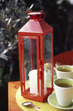 Cups of tea and lantern Stock Images