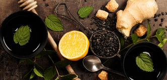 Cups of tea, lemon, ginger and mint Stock Images