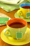 Cups of tea. Served on a table inside the bag Stock Images