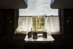 Cups of tea on the table in the train stock images
