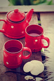 Cups with tea, teapot and cookies Royalty Free Stock Photo