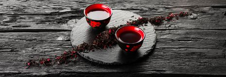 Cups of tea and teapot on black wooden table Royalty Free Stock Photography