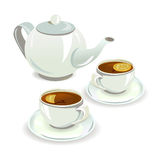 Cups with tea and teapot Stock Images