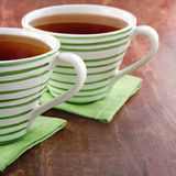 Cups of tea on wooden background Stock Image