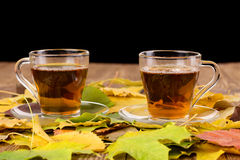Cups of tea on a wooden table Stock Photo