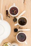 Cups and teapot on a wooden board Royalty Free Stock Photography