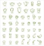 Cups and teapots doodles. Cups, cupcakes, fruits and teapots doodle icons Stock Images
