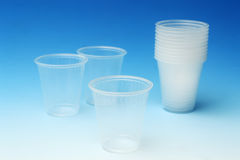 Cups. Transparent disposable cups with blue background Stock Image