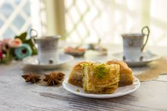 Cups of Turkish coffee and a plate with baklava Royalty Free Stock Photography