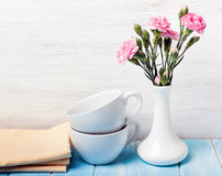 Cups, vase and flowers Stock Image