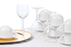 Cups and Wine Glasses on Restaurant Table Stock Photo