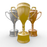 Cups of winner on white background Stock Photo