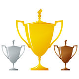 Cups of winners, golden, silver and bronzed trophy Royalty Free Stock Photo