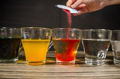 Free Cups With Colored Water For Easter Stock Photography - 142455332