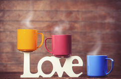 Cups and word love Royalty Free Stock Photos
