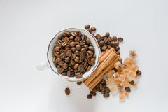 Cupwith coffee beans Stock Images
