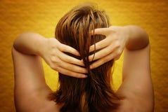 Cura circa capelli Fotografia Stock