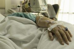 Cura del paziente in un ospedale Fotografie Stock