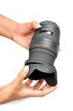 Cura di Lense immagini stock