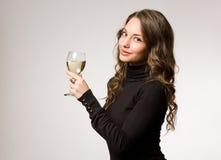 Cura per un vetro di vino? Immagine Stock