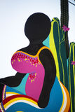 Curacao art, big mama. Art from Curacao. Wooden sign of a woman with a colourfull dress Royalty Free Stock Images