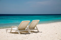 Beach Chairs looking over de ocean. Two beach chairs looking of the Caribbean Sea stock photography
