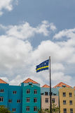 Curacao Flag by Colorful Buildings Royalty Free Stock Photos