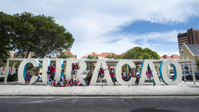 Curacao huge letters at streets of Punda. Children playing in the huge letters of Curacao at Wilhelminapark in the city centre of Punda, Willemstad,  Curacao Stock Image