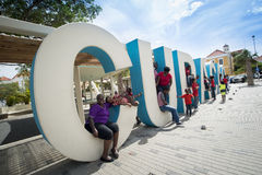 Curacao huge letters at streets of Punda. Children playing in the huge letters of Curacao at Wilhelminapark in the city centre of Punda, Willemstad,  Curacao Royalty Free Stock Images