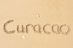 Curacao. A picture of the word Curacao drawn in the sand stock images
