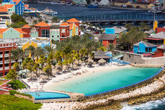 Curacao with Queen Emma Bridge. The Queen Emma Bridge is a pontoon bridge across St. Anna Bay in Curaçao. It connects the Punda and Otrobanda quarters of the Stock Photo