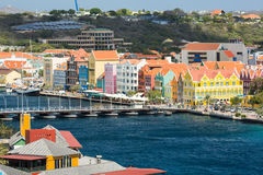 Curacao with Queen Emma Bridge in Willemstad. The Queen Emma Bridge is a pontoon bridge across St. Anna Bay in Curaçao. It connects the Punda and Otrobanda Stock Images