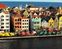 Curacao Waterfront. The photo shows the waterfront along the primary inlet to the harbor of Curacao. The view encorporates the typical dutch architecture along Stock Images
