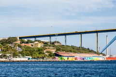 Curaco Bridge with Colorful Buildings and Blue Channel Stock Photo