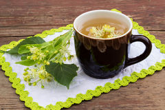 Curative tea with lime blossom Royalty Free Stock Photography