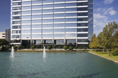 Curb Appeal. Modern office building with water and fountains create curb appeal Stock Image