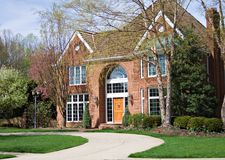 Curb appeal. Beautiful suburban Ohio home - driveway sweeps up Royalty Free Stock Photo
