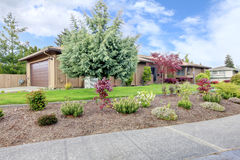 Curb appeal. House with landscaped front yard Stock Images