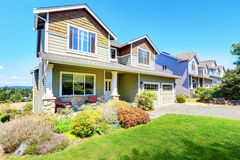 Curb appeal of luxury family house with nice landscape. Northwest, USA Royalty Free Stock Images