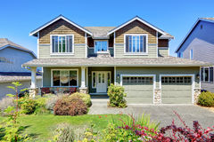Curb appeal of luxury family house with nice landscape. Northwest, USA Royalty Free Stock Photo