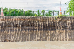 The curb erosion from storms. To indicate the layers of soil Stock Images